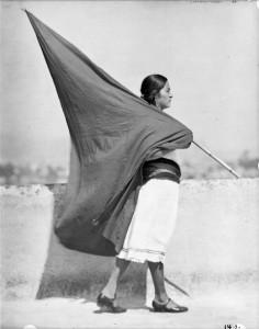 Mujer con bandera (Woman with Flag), 1928. © 35273, Tina Modotti, Secretaría de Cultura-INAH-SINAFO-FOTOTECA NACIONAL-MÉXICO